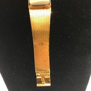 Oleg Cassini Accessories - Oleg Cassini gold tone four diamond quartz  watch.
